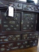 AN ANTIQUE JAPANESE TABLE CABINET VARIOUSLY DECORATED WITH BRONZE MINUKI TYPE MOUNTS
