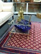 A PIERE VANDEL MID CENTURY TWO TIER GLASS TOP COFFEE TABLE ON LUCITE SUPPORTS. TOP 108 x 57cms H.40