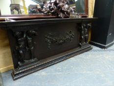 A 19th.C.CARVED OAK PANEL POSSIBLY AN OVERMANTLE WITH FLORAL SWAG FLANKED BY CHERUBS. W.145cms.