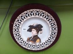 AN ANTIQUE CONTINENTAL PIERCED BORDER CABINET PLATE DECORATED WITH A PORTRAIT BUST OF A YOUNG LADY