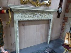 A 19th.C.CARVED AND PAINTED PINE FIRE SURROUND. THE MANTLE W.160 x H.139cms. OVERALL