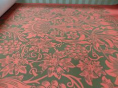 A ROLL OF MORRIS & Co DESIGN WALLPAPER OF FLORAL DESIGN ON A RED GROUND, AS NEW.