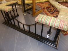 A LARGE WROUGHT IRON CLUB FENDER WITH UPHOLSTERED ENDS AND DROP CENTRE. W.165cms.