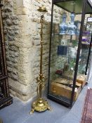 A GOOD ANTIQUE ARTS AND CRAFTS BRASS STANDARD LAMP NOW WITH ELECTRICAL FITTING.