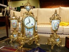 A 19th.C.FRENCH STYLE GILT BRASS CLOCK GARNITURE WITH DECORATED PORCELAIN PANELS.