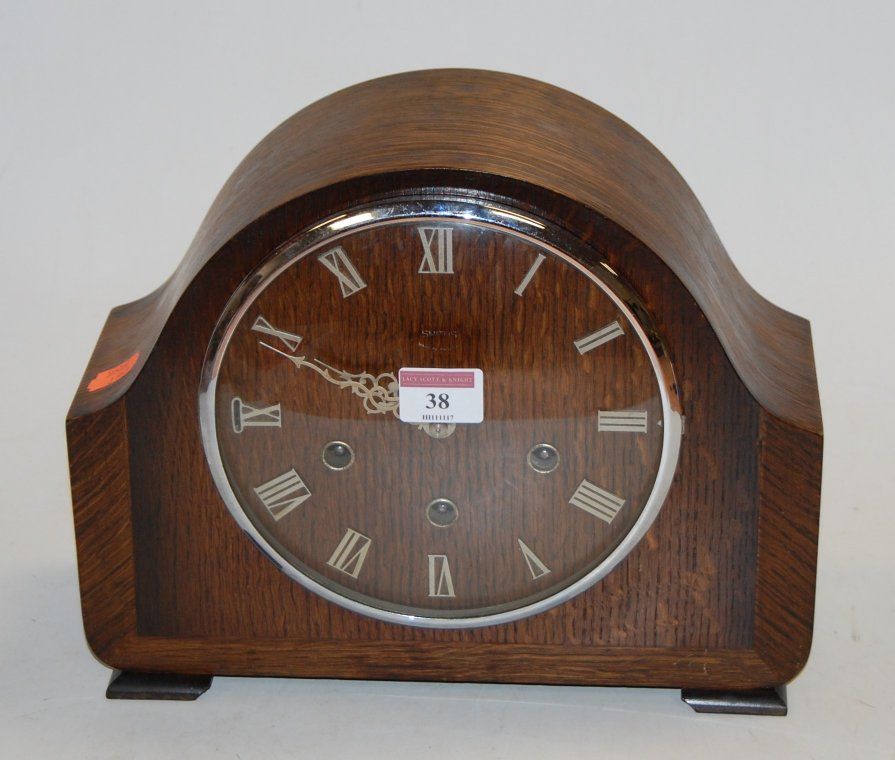 Lot 38 - A 1950s Smith's oak cased mantel clock,