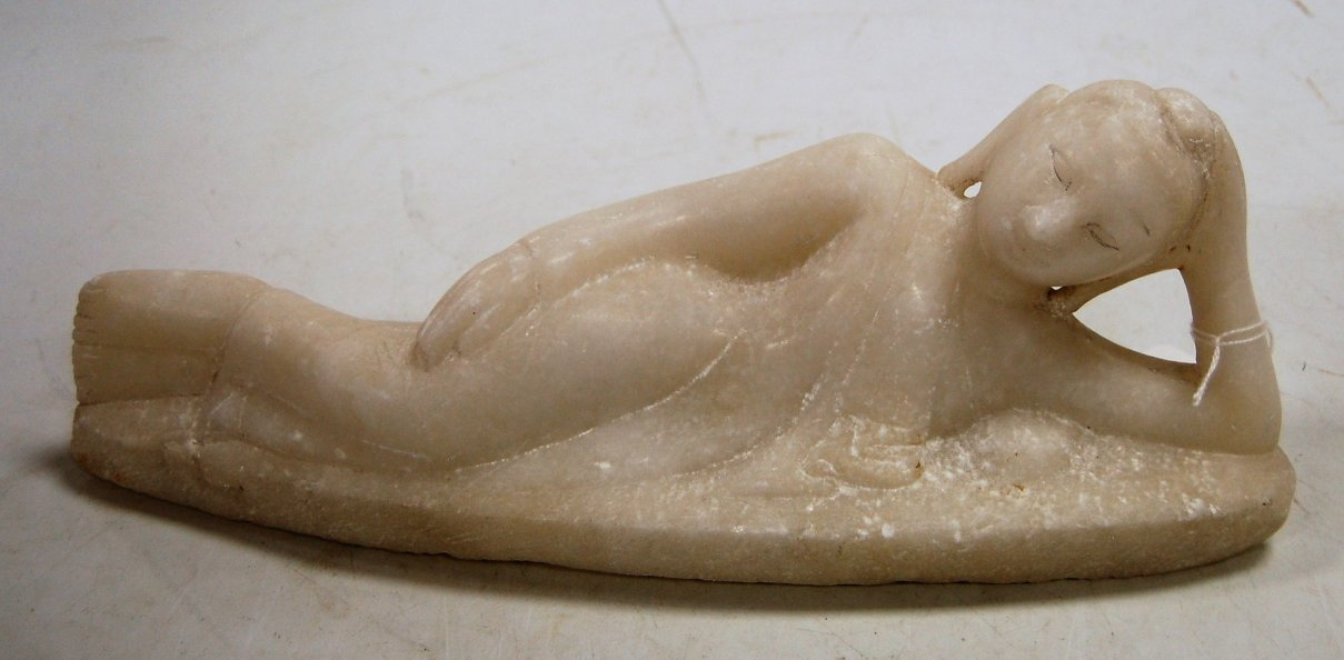 Lot 59 - A carved alabaster figure of a reclining goddess, w.
