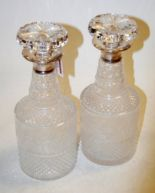 Lot 44 - A pair of 20th century cut glass decanters, each having silver mounted collar and mushroom stopper,