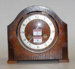 Lot 4 - A 1930s oak cased mantel clock,
