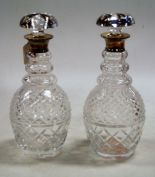 Lot 19 - A pair of modern hobnail cut glass decanters, each with silver collar and mushroom stopper, h.