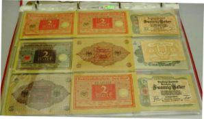 1 Ordner mit 12 Seiten gefüllt mit Geldscheinen, dabei Darlehenskassenscheine, 3 Banknoten BRD