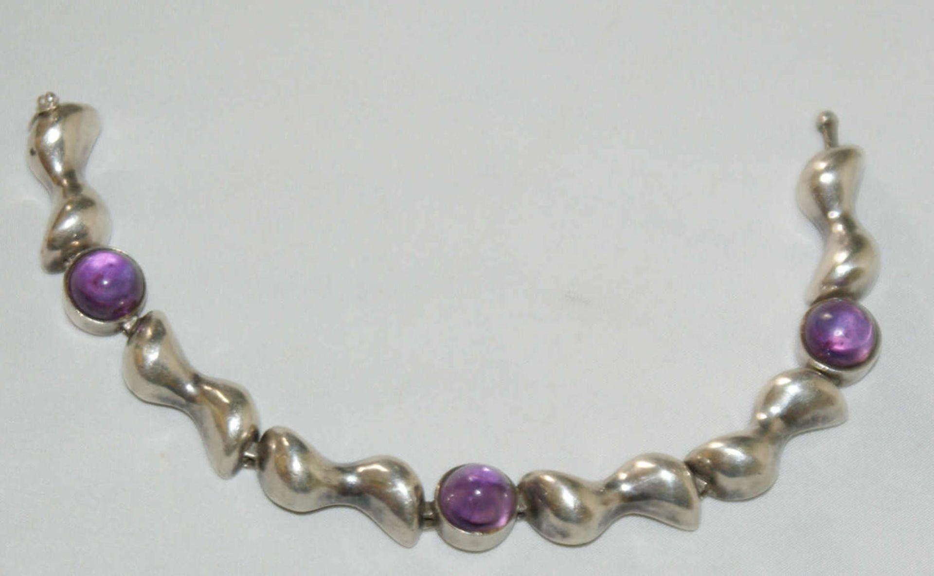 Silberarmband, 835er Silber, besetzt mit Amethysten. Länge ca. 19 cm, Gewicht ca. 32 gr
