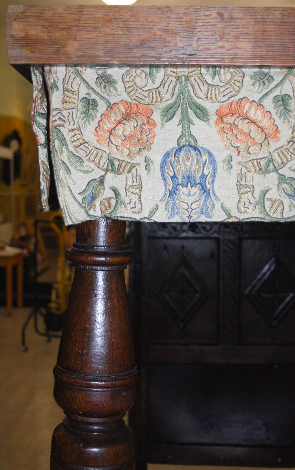 Lot 37 - A 17th century style oak single four poster bed, the rectangular panelled top with foliate fringe,