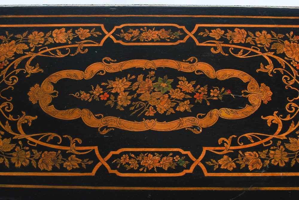 Lot 52 - A late 19th/early 20th century walnut, penwork and gilt metal mounted coffee table, the