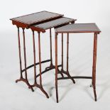 Lot 66 - A nest of three 19th century rosewood Regency style occasional tables, the rectangular tops raised