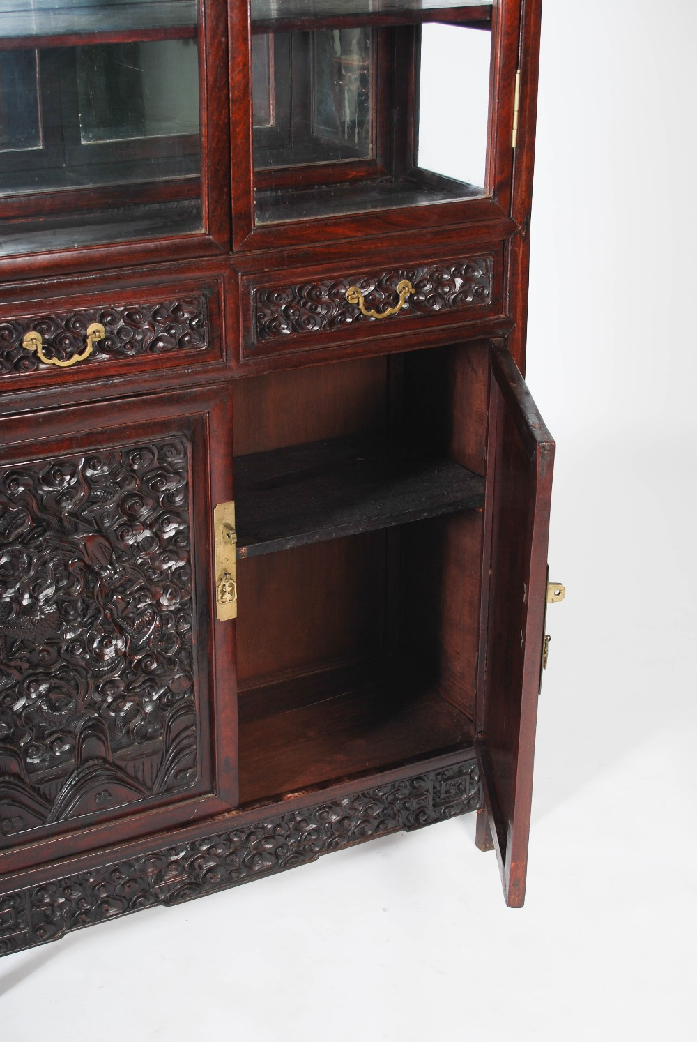 Lot 53 - A Chinese dark wood mirror back display cabinet, the upper section with a pair of glazed cupboard