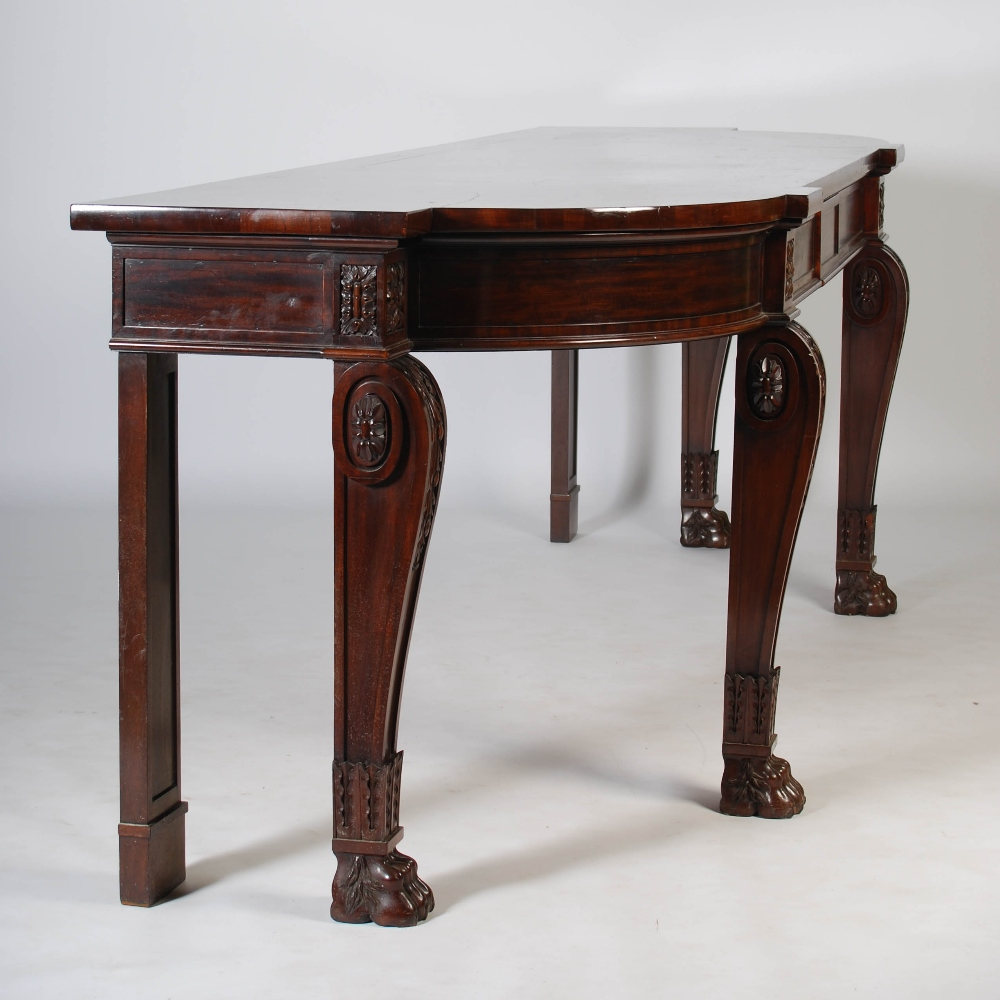 Lot 62 - An impressive William IV mahogany serving table, the shaped rectangular top above two blind frieze