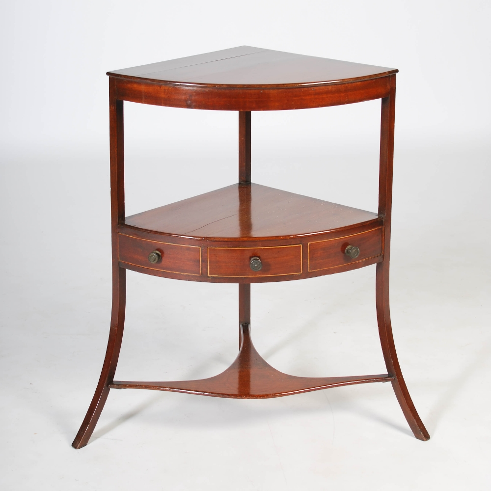 Lot 35 - A George III mahogany and boxwood lined two tier corner wash stand, the lower tier fitted with a