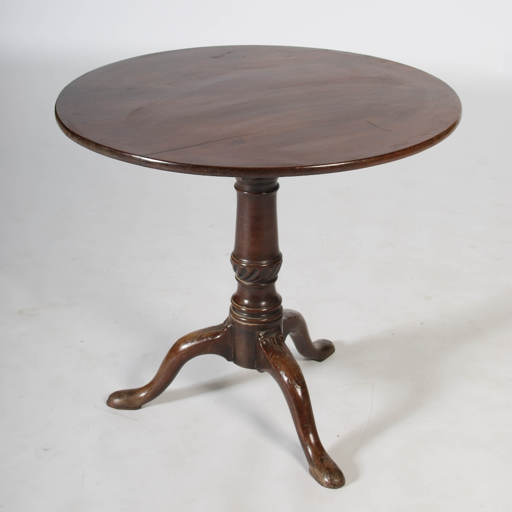 Lot 82 - A George III mahogany snap top tripod table, the hinged circular top resting on a bird cage and