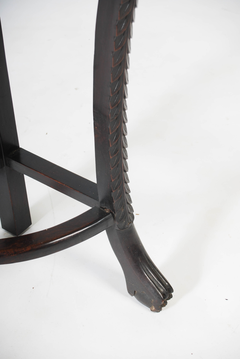 Lot 84 - A Chinese dark wood corner shaped jardiniere stand, Qing Dynasty, the shaped top with a mottled