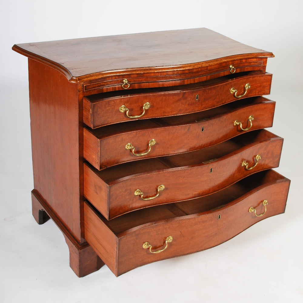 Lot 64 - A 19th century mahogany serpentine chest, the shaped rectangular top with a moulded edge, above a