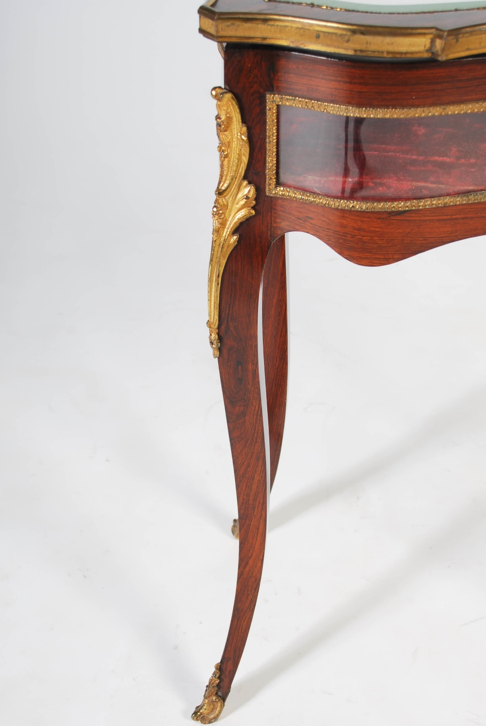 Lot 87 - A late 19th century rosewood and ormolu mounted kidney shaped bijouterie table, the hinged top