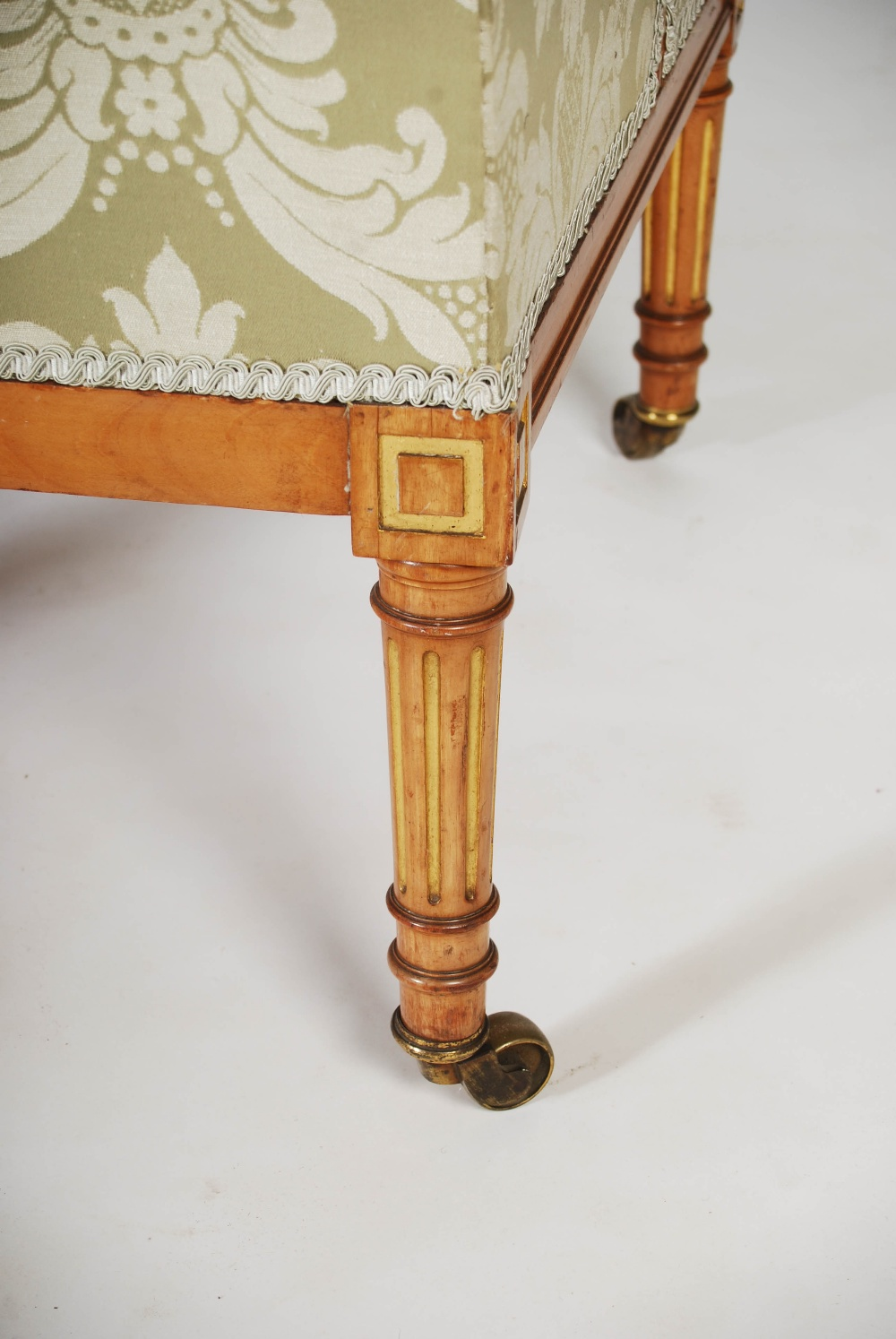 Lot 101 - A pair of Edwardian mahogany and parcel gilt tub chairs, the button down upholstered backs, arms and