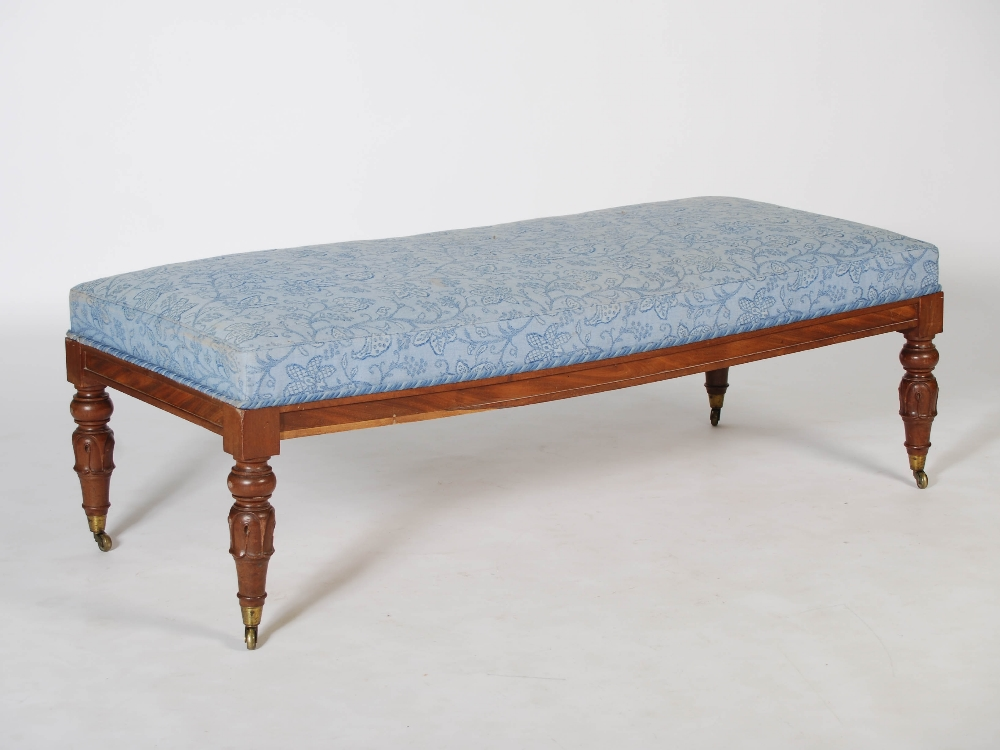Lot 11 - A 19th century mahogany rectangular stool, the blue foliate upholstered top raised on four tapered