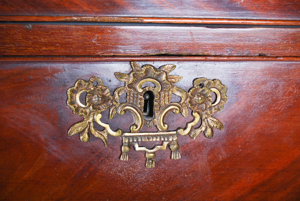 Lot 76 - A George III mahogany chest on chest, the moulded cornice above three short and three long graduated