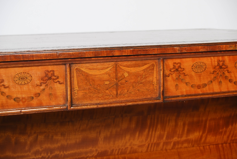 Lot 112 - A late 19th century Neo Classical style satinwood and marquetry inlaid double sided open bookcase,