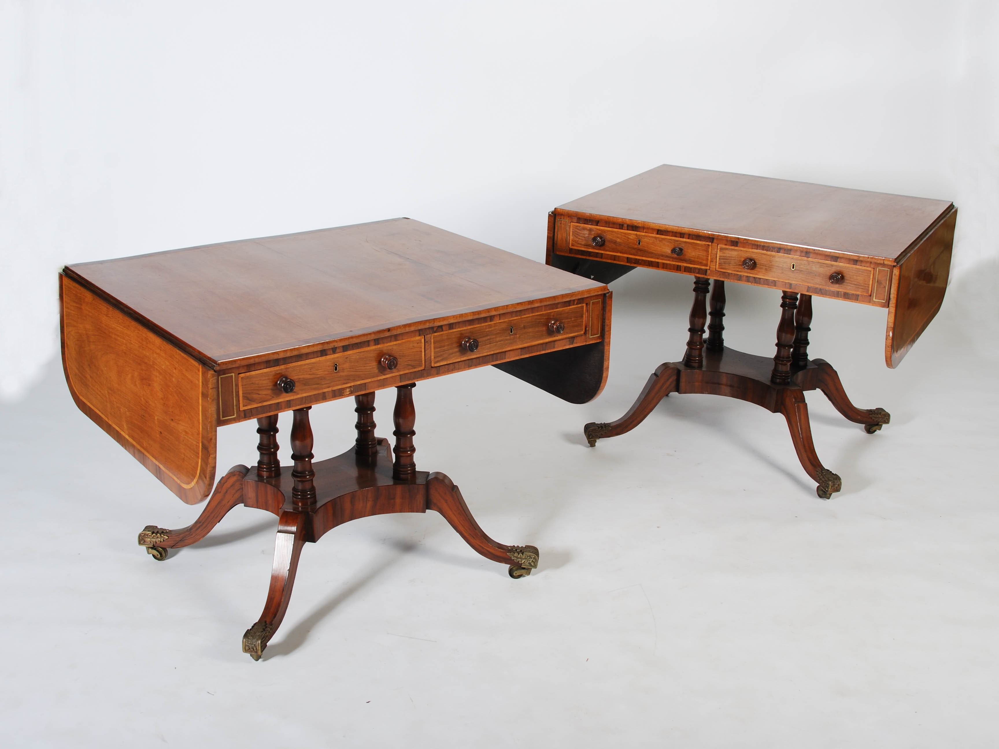 Lot 46 - A pair of 19th century mahogany, rosewood and brass inlaid sofa tables, the rectangular tops with
