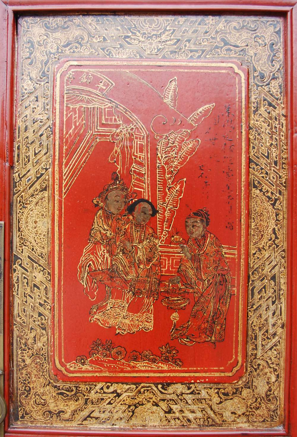 Lot 11B - A Chinese red lacquer marriage cabinet, with four panelled cupboard doors decorated with panels of