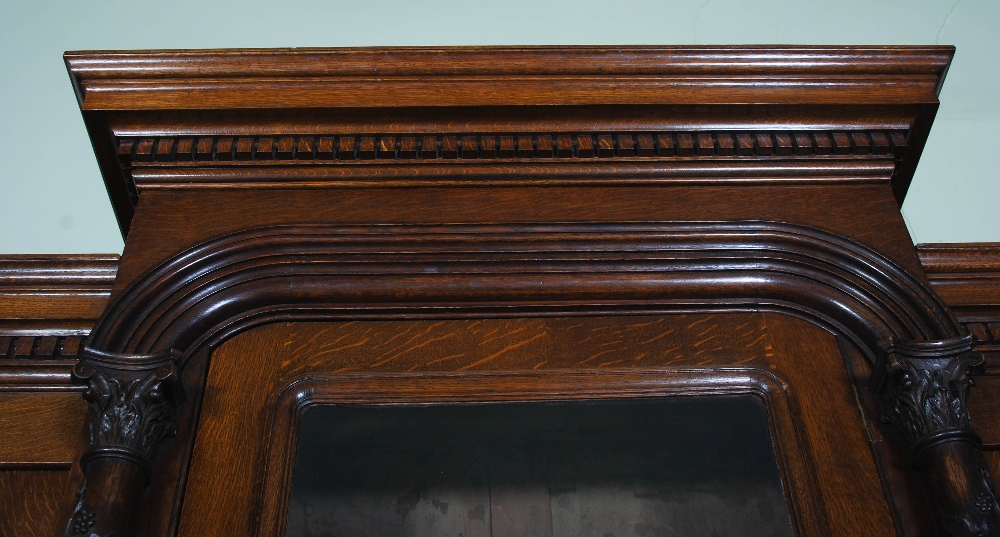 Lot 94 - A Victorian oak breakfront bookcase, with moulded cornice and dentil frieze above a central