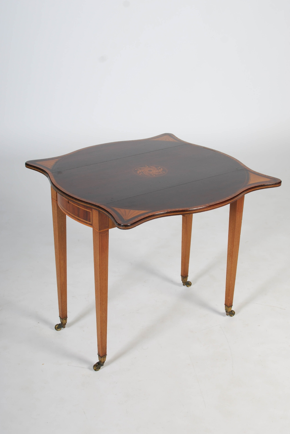 Lot 115 - An Edwardian mahogany and satinwood banded Pembroke table in the George III style, the shaped top
