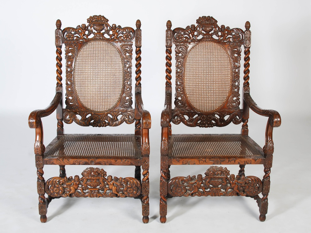 Lot 60 - A pair of late 19th century Carolean style carved walnut armchairs, the top rails carved and pierced