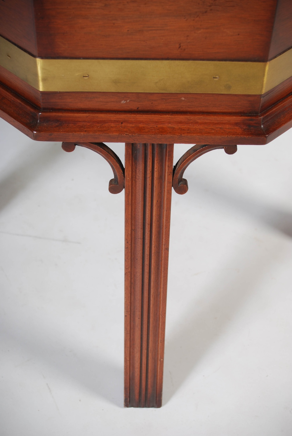 Lot 20 - A reproduction George III mahogany and brass bound octagonal shaped wine cooler, the hinged cover