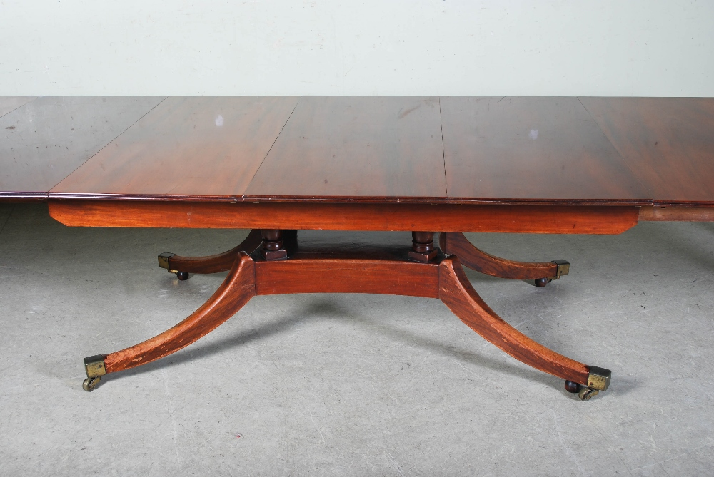 Lot 44 - A 19th century mahogany extending pedestal dining table, the rectangular top enclosing five
