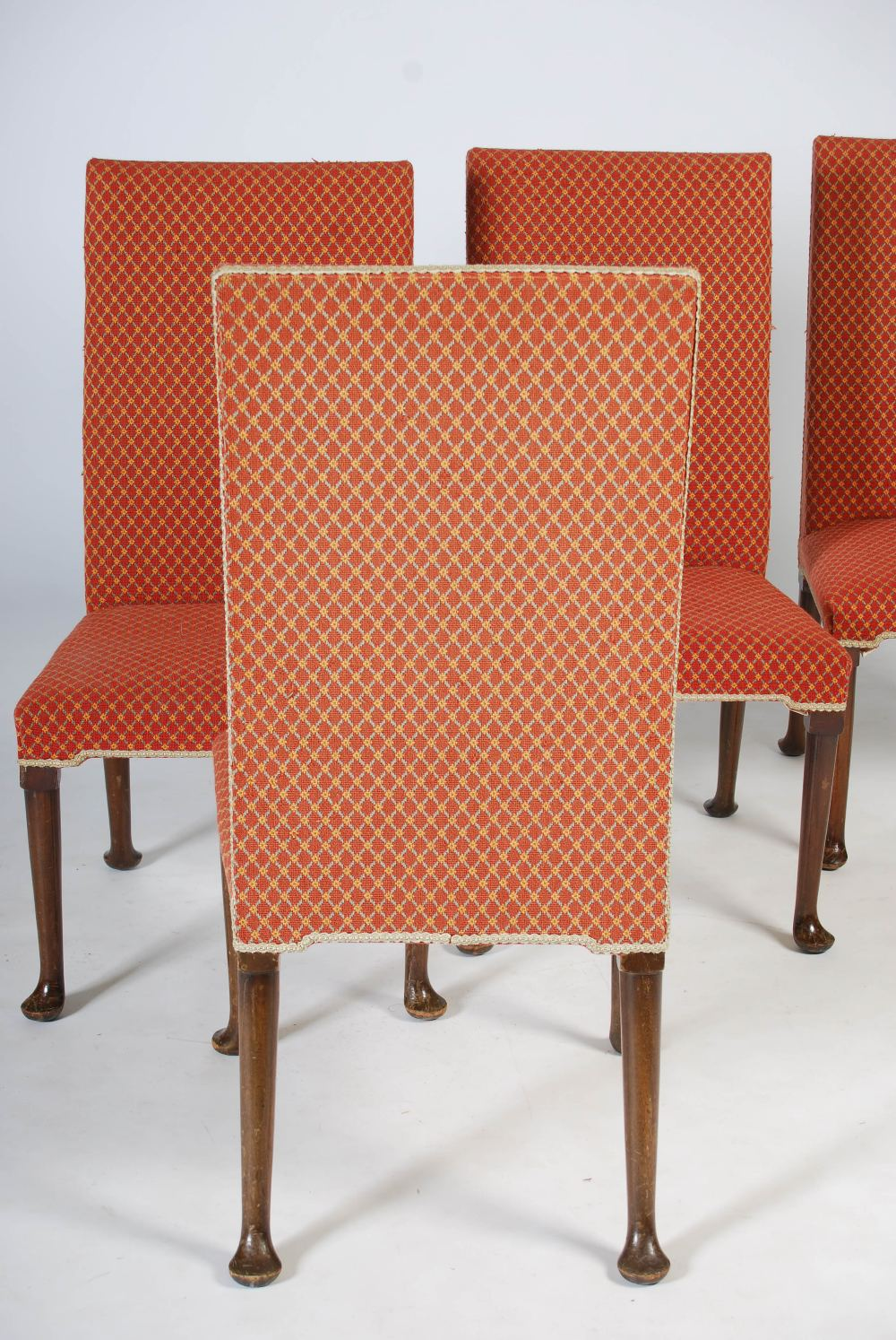Lot 23 - A set of ten early 20th century mahogany dining chairs, the needlework backs and seats raised on