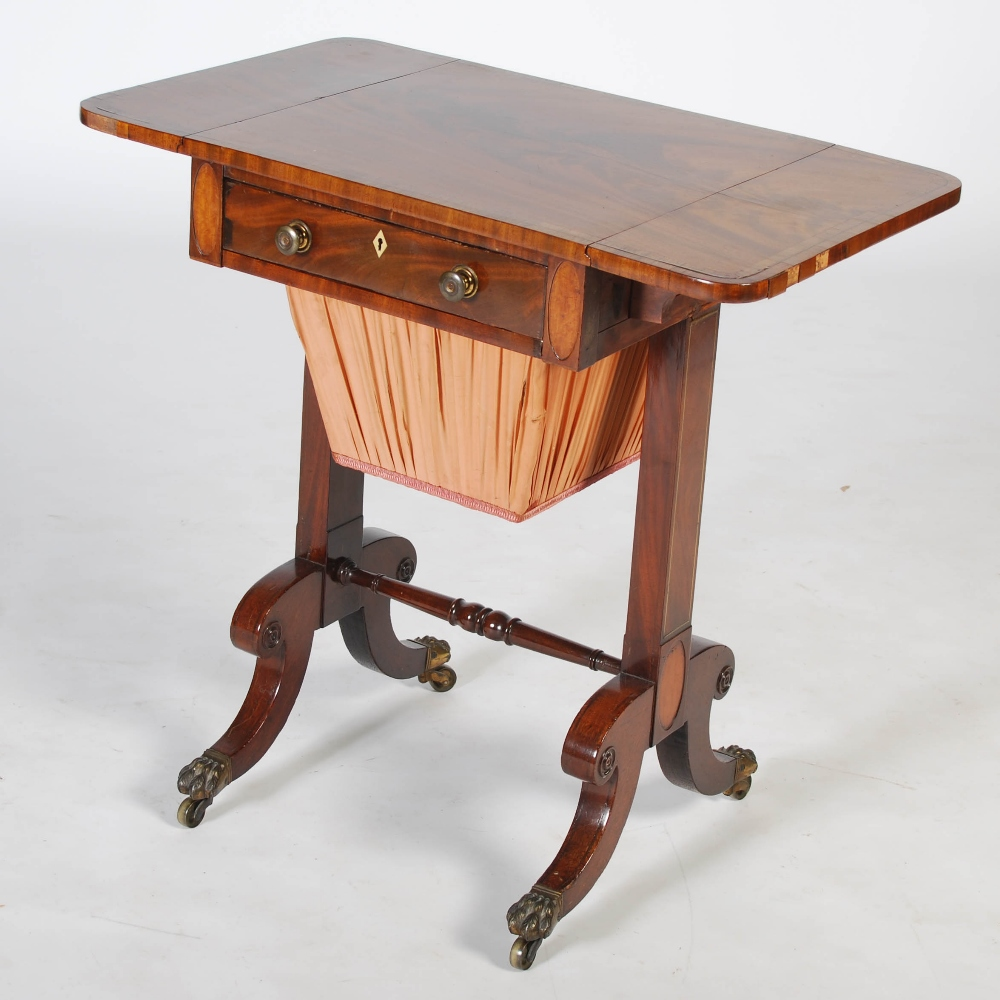 Lot 116 - A Regency mahogany, rosewood and brass inlaid work table, the rectangular top with twin drop leaves,