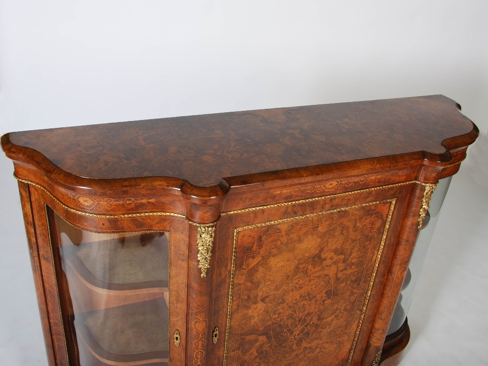 Lot 55 - A Victorian walnut and gilt metal mounted credenza, the shaped top above a panelled cupboard door
