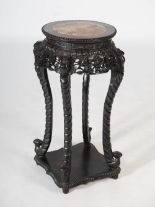 Lot 83 - A Chinese dark wood jardiniere stand, Qing Dynasty, the circular top with mottled red marble insert,