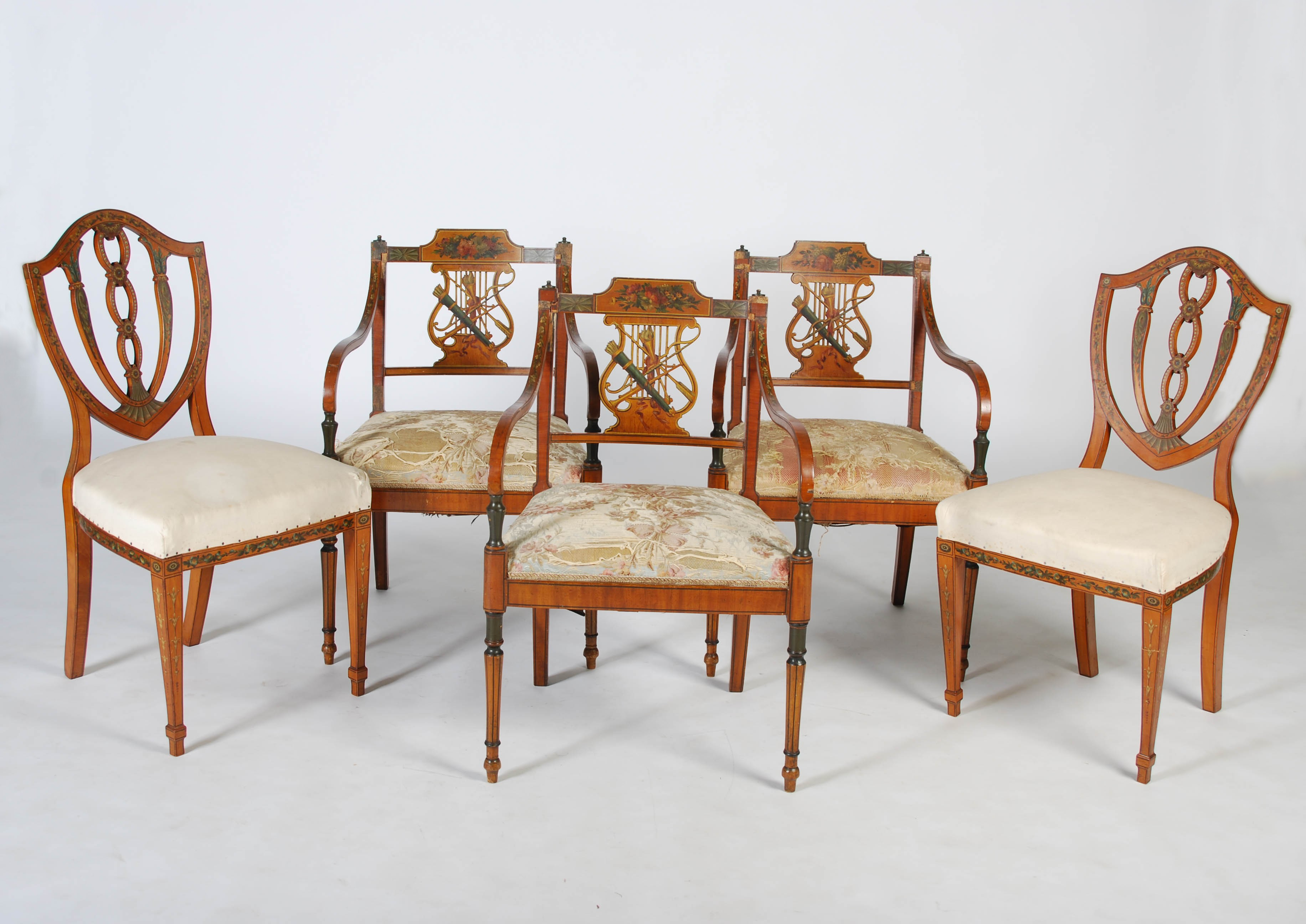 Lot 16 - A set of three 19th century painted satinwood armchairs and a pair of 19th century painted satinwood