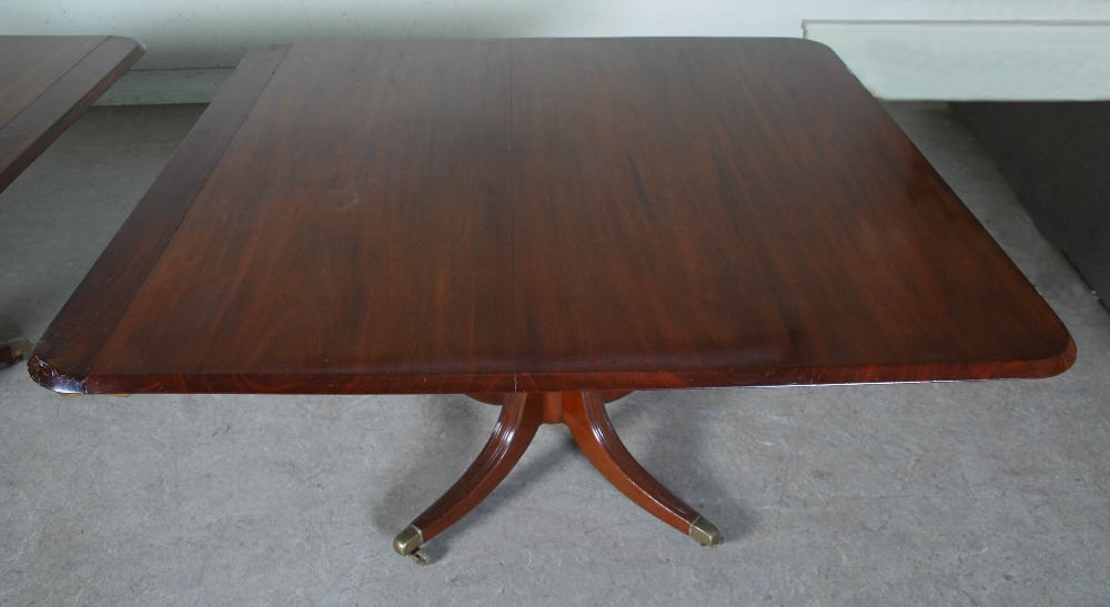 Lot 22 - A 19th century mahogany twin pedestal dining table converting to two square snap top pedestal tables