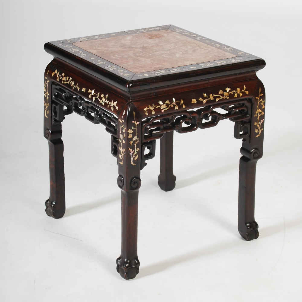 Lot 28 - A Chinese dark wood and mother of pearl inlaid jardiniere stand, Qing Dynasty, the square top with