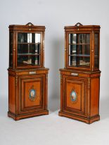 Lot 90 - A pair of Victorian satinwood, ormolu and porcelain mounted display cabinets, the upper sections