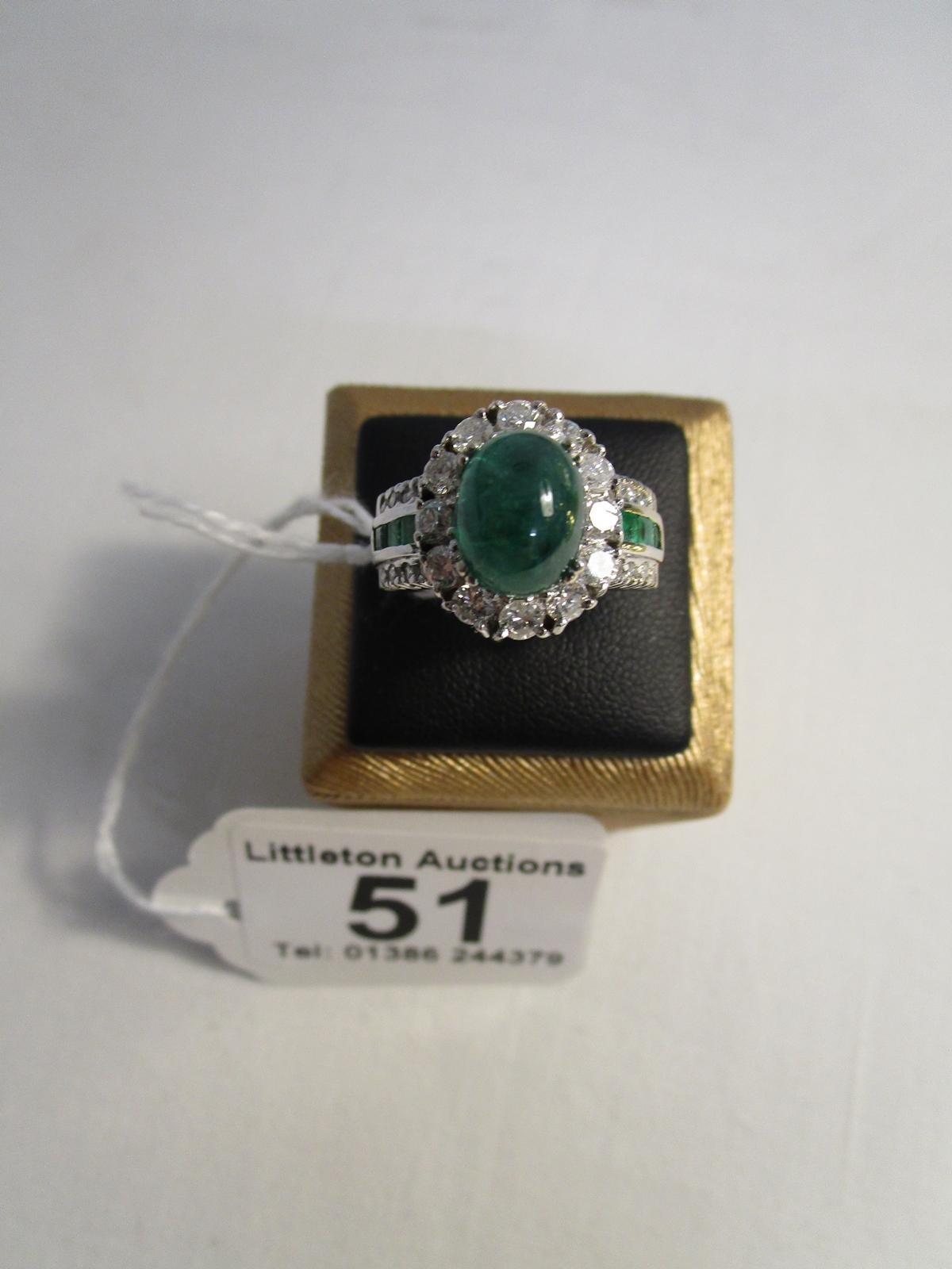 Lot 51 - Fine platinum set emerald & diamond set ring
