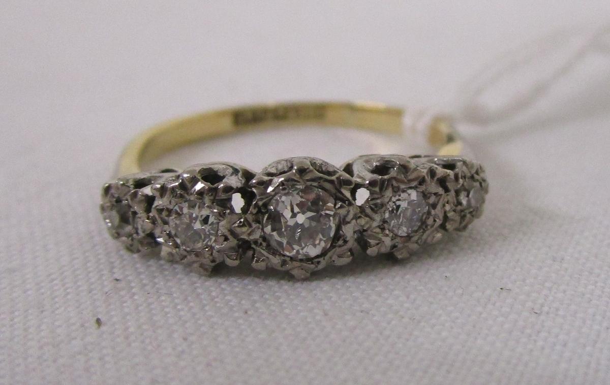 Lot 12 - 18ct platinum set 5 stone diamond ring