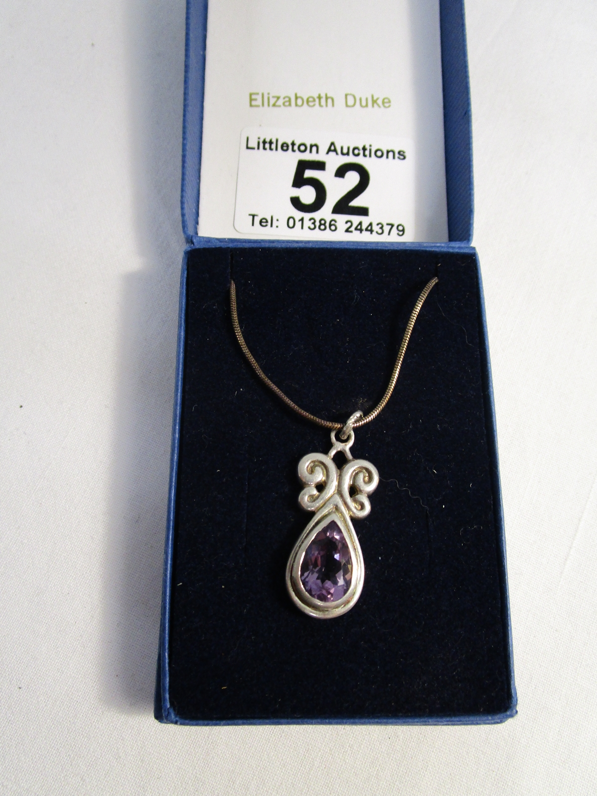 Lot 52 - Silver & amethyst pendant on chain