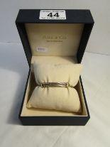 Lot 44 - 18ct Gold & 5 strand silver slider bangle, original box, Furr of Hungerford (still retails at £680)