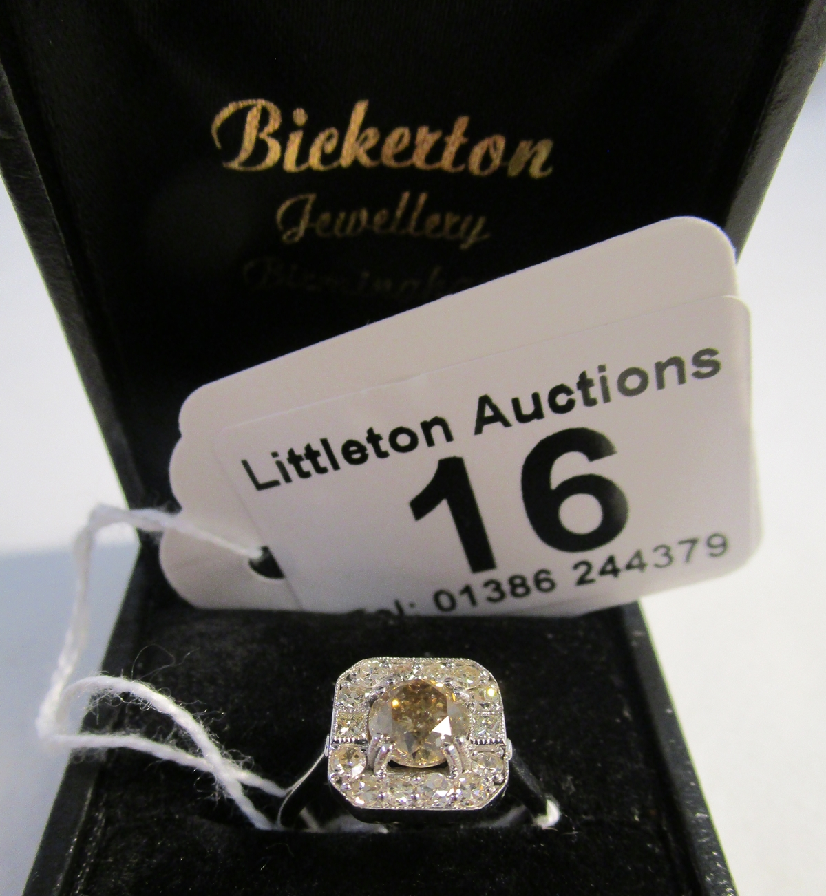 Lot 16 - Fine 18ct white gold cinnamon diamond surrounded by brilliant cut & baguette diamonds